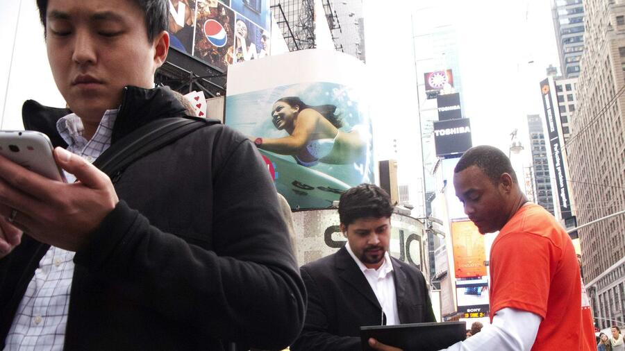 IT-Kunden am New Yorker Times Square. Quelle: AFP