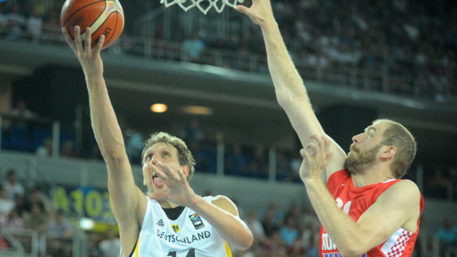 newest collection 3ae0d 84785 Big Dirk goes for a score during Germany s friendly match against Croatia  last month. The German basketball star Dirk Nowitzki ...