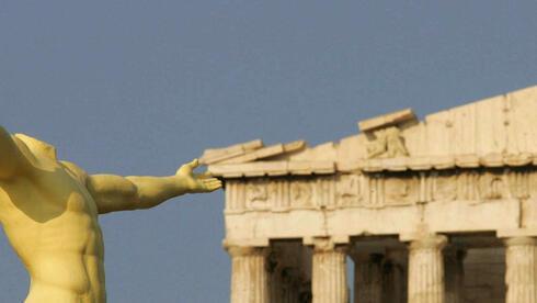 Neuer Schuldenschnitt für Griechenland? Es wird weiter diskutiert - auch auf einem Geheimtreffen. Quelle: dpa