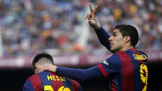 Barcelona's Suarez and Messi celebrate a goal against Rayo Vallecano during their Spanish first division soccer match in Barcelona
