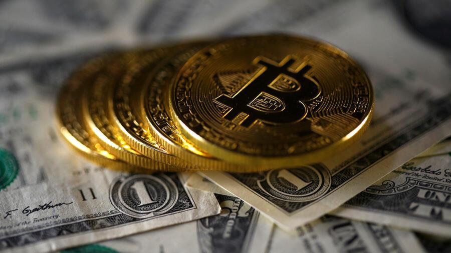 Wie viel Bitcoin ist gleich 1 Dollar?