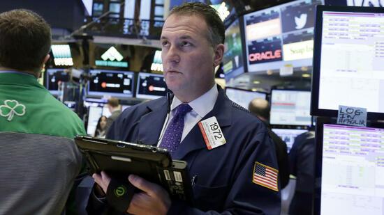 Händler an der Wall Street Am Mittwoch stand die Politik im Mittelpunkt. Quelle AP