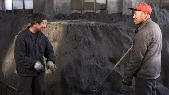 COAL WORKERS TAKE A BREAK AT A COAL PROCESSING PLANT IN BEIJING