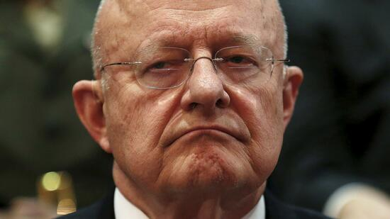 Director of National Intelligence Clapper listens to remarks by U.S. President Obama in McLean
