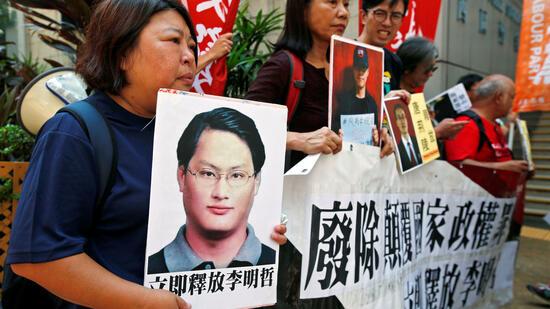 Angeklagt in China: Menschenrechtsaktivist bekennt sich schuldig