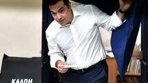 huGO-BildID: 46474224 Greek Prime Minister Alexis Tsipras comes out of a polling booth during the Greek referendum in Athens on July 5, 2015. Greek voters headed to the polls today to vote in a historic, tightly fought referendum on whether to accept worsening austerity in exchange for more bailout funds, in a gamble that could see it crash out of the euro. AFP PHOTO / ARIS MESSINIS Quelle: AFP