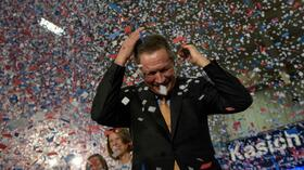TOPSHOT - Republican US Presidential hopeful Ohio Governor John Kasich celebrates his Ohio primary victory during voting day rally at Baldwin Wallace University March 15, 2016 in Berea, Ohio. / AFP PHOTO / Brendan Smialowski Quelle: AFP