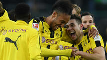 Dortmund's Portuguese defender Raphael Guerreiro and Dortmund's Gabonese striker Pierre-Emerick Aubameyang react after the German first division Bundesliga football match of Borussia Moenchengladbach vs Borussia Dortmund in Moenchengladbach, western Germany, on April 22, 2017. / AFP PHOTO / PATRIK STOLLARZ / RESTRICTIONS: DURING MATCH TIME: DFL RULES TO LIMIT THE ONLINE USAGE TO 15 PICTURES PER MATCH AND FORBID IMAGE SEQUENCES TO SIMULATE VIDEO. == RESTRICTED TO EDITORIAL USE == FOR FURTHER QUERIES PLEASE CONTACT DFL DIRECTLY AT + 49 69 650050 Quelle: AFP