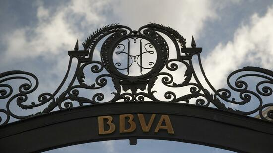 The logo of Spain's BBVA bank is seen on a gate in Madrid