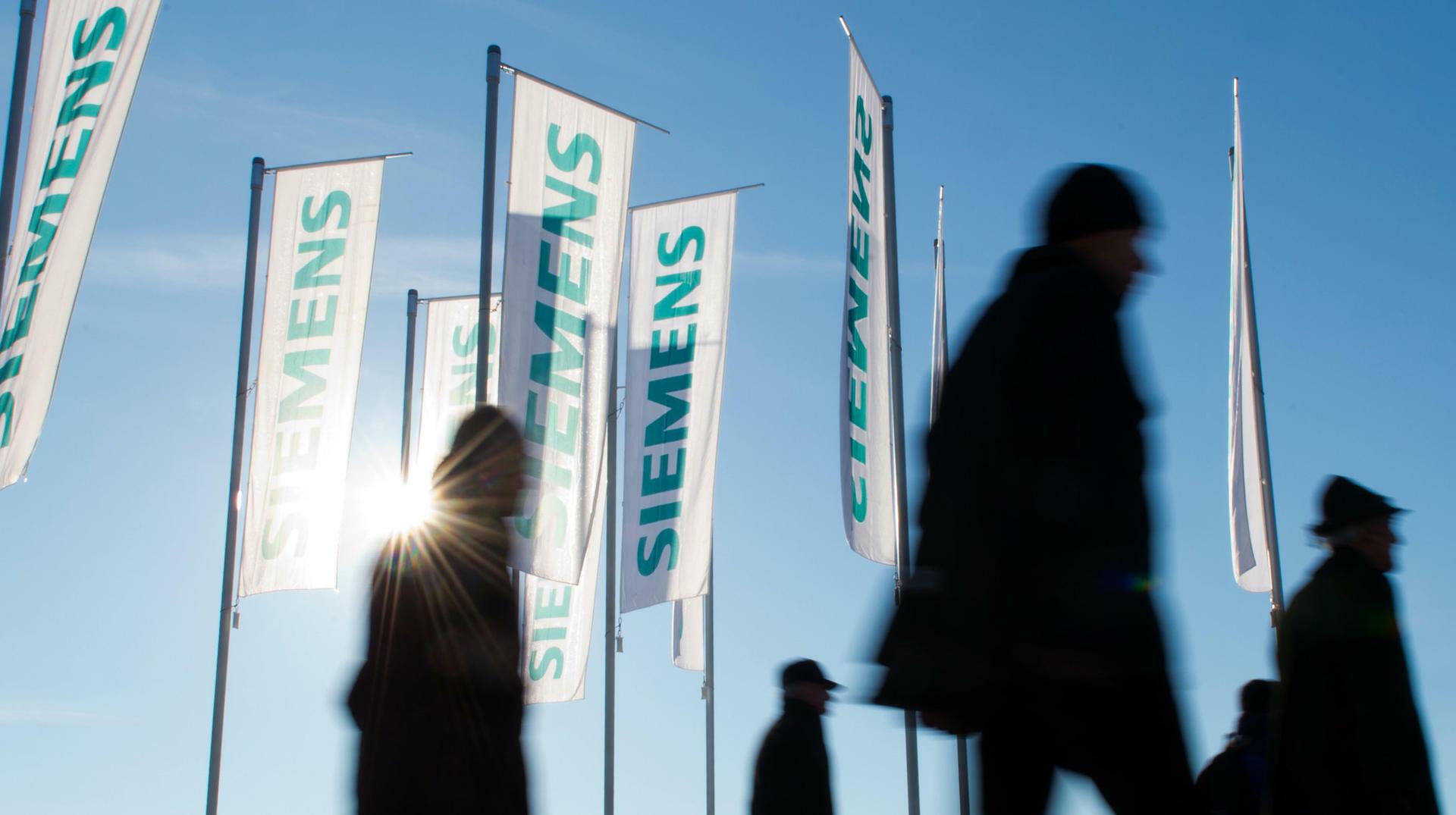 Siemens baut weltweit rund 7800 Stellen ab. Quelle: dpa